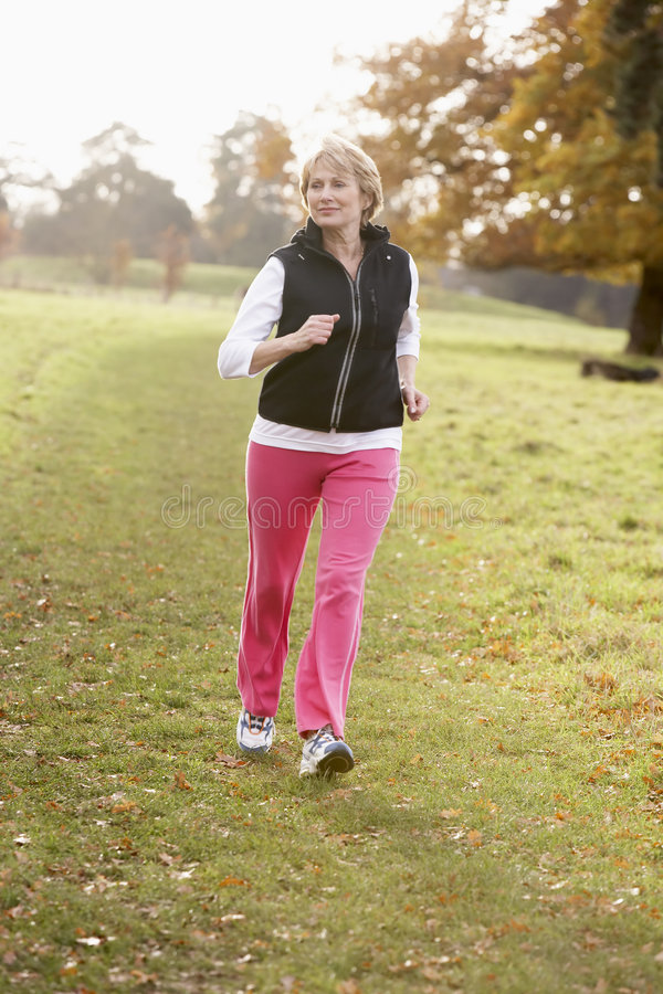 power senior walking woman στοκ εικόνες