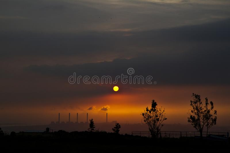Power station at dusk. Impact of pollution on air quality shown by a power station at dusk royalty free stock images