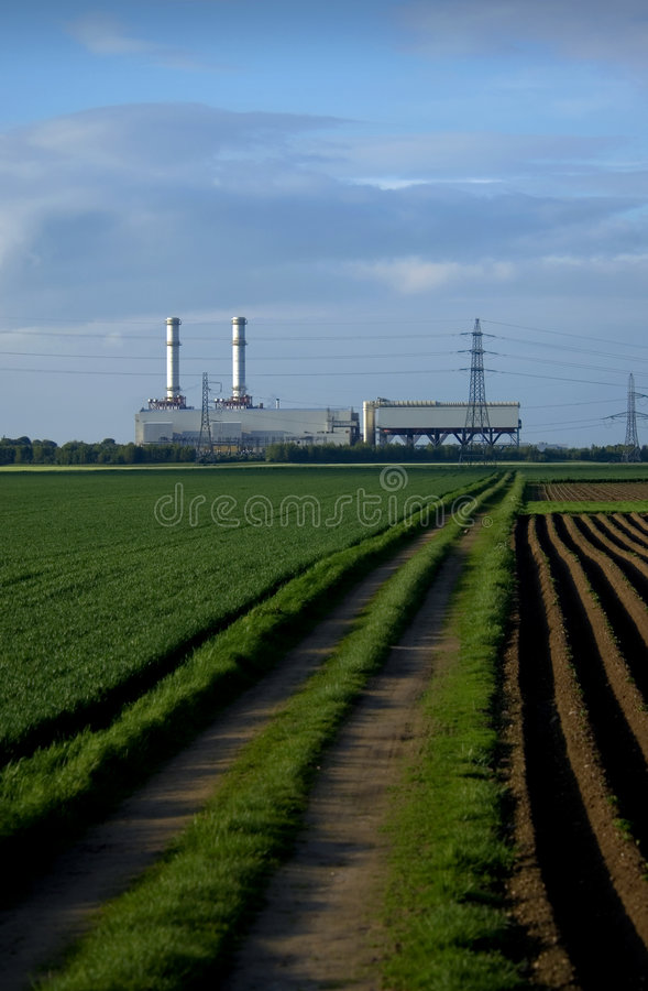 Power station in fields royalty free stock photos