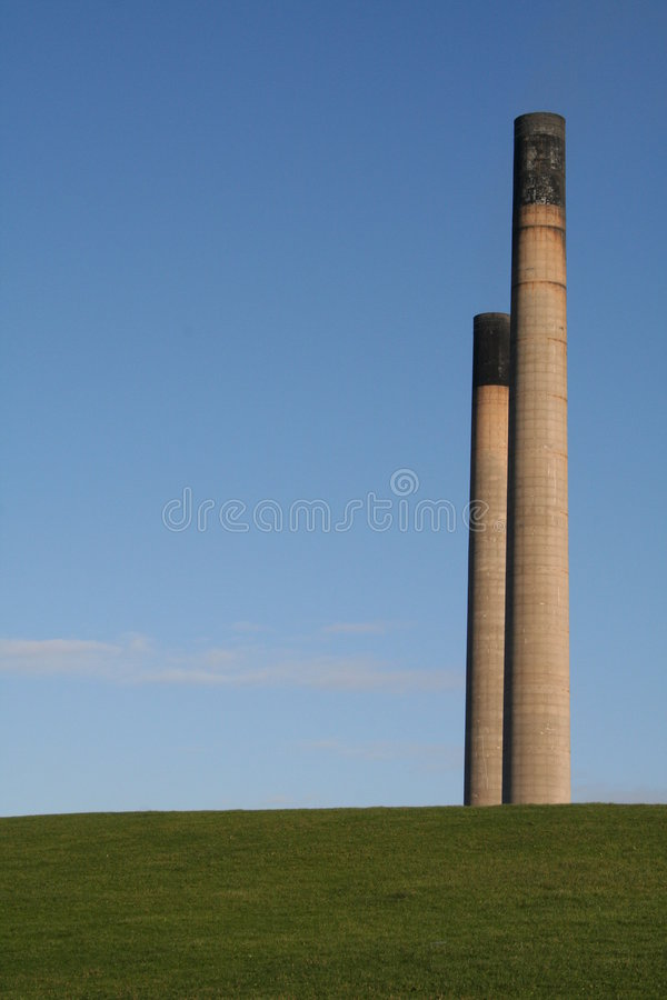 Power station over green field. royalty free stock photo
