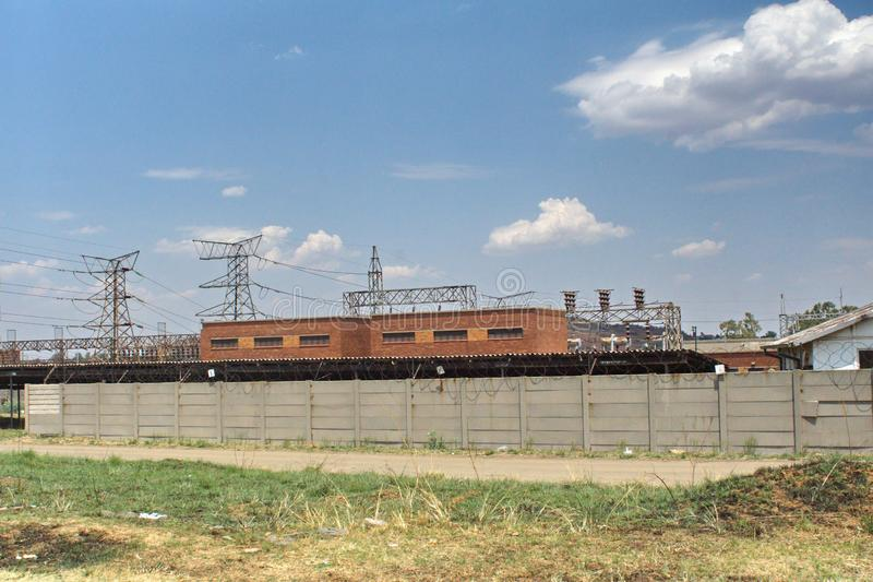 Power station in Soweto. Power station and power lines running through Soweto, the township south of Johannesburg, South Africa royalty free stock photo