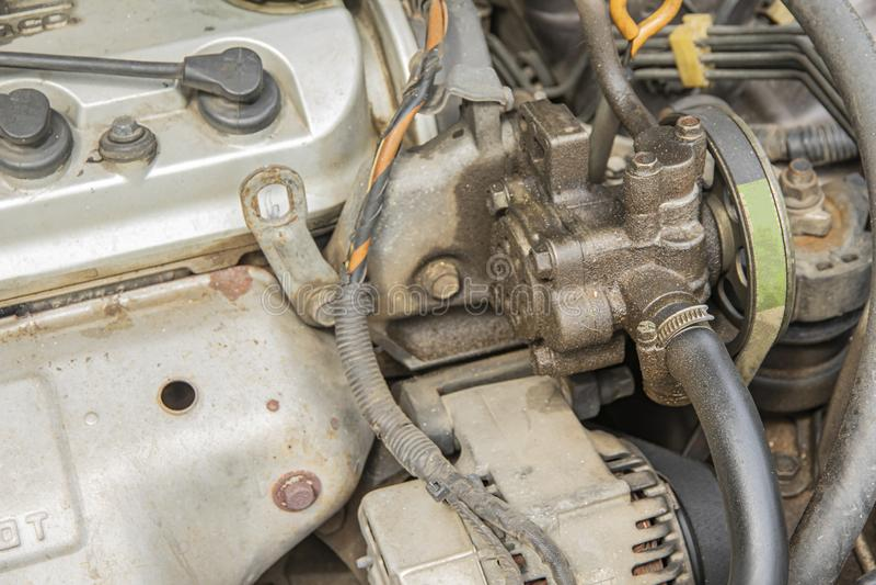 Power steering pump is leaking oil from gasket stock photo