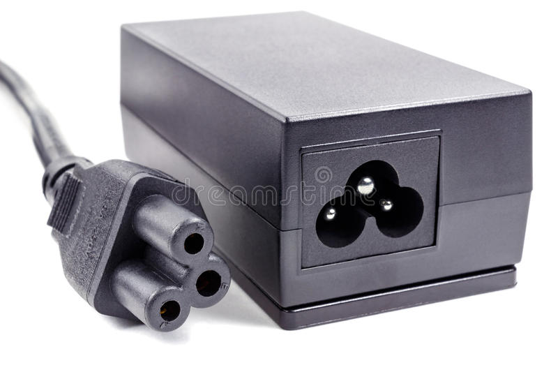 Power supply adaptor with cable on a white background stock photos
