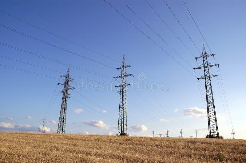 Power supply poles stock photos