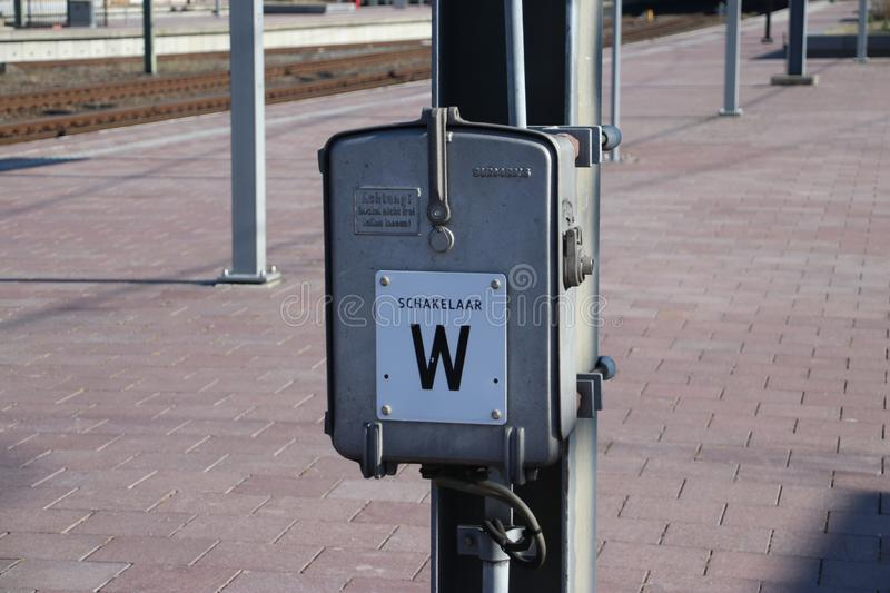 Power switch named W for electricity wires for trains on platform on railroad station Rotterdam Centraal in the Netherlands. royalty free stock photography