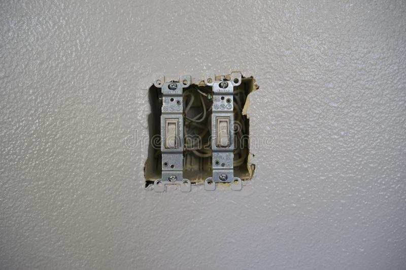 Power Switches for lights with out cover. Light switches with exposed wiring with no cover on stock image