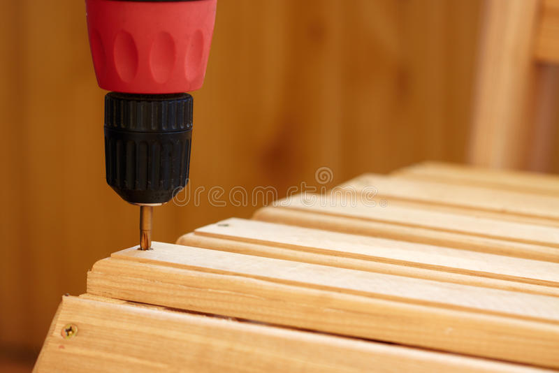 Power Tool. Drilling Down a into Wood stock photos