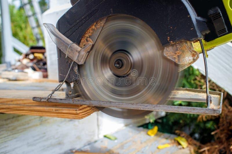 Power Tool Circular Saw. Old worn circular saw power tool cutting wood stock photos