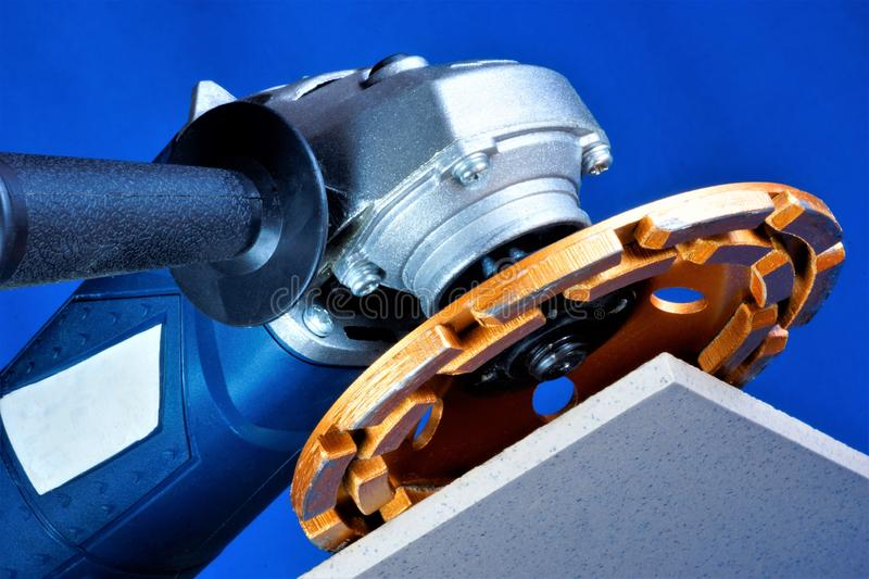 Power tool grinding—diamond machining of the material. Diamond abrasive machining of the nozzle repair, the construction for. Processing hard materials royalty free stock images