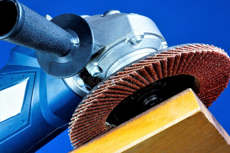 Power tool grinding—mechanical processing of the material. Abrasive processing is used in repair, construction for processing of. Hard brittle materials royalty free stock image
