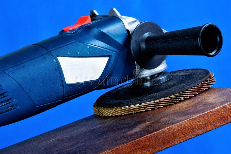 Power tool grinding—mechanical processing of the material. Abrasive processing is used in repair, construction for processing of stock photography