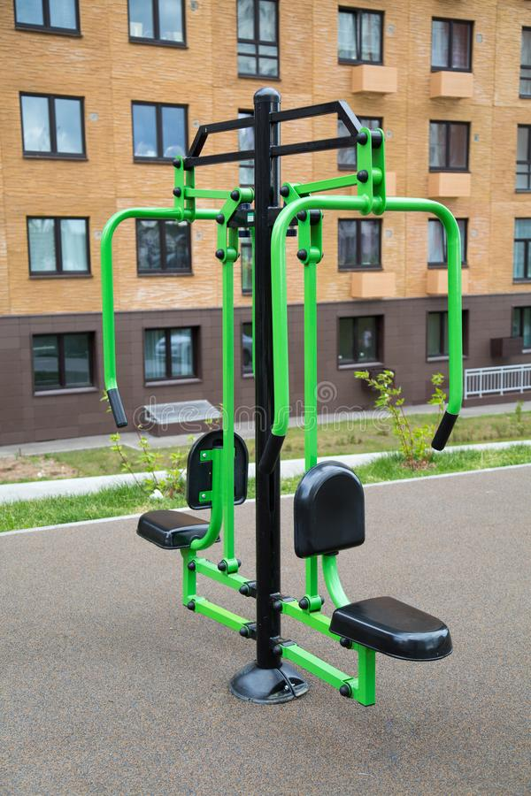 Power trainer for hand muscles made of metal on the Playground in the city outdoors. Sport is a healthy royalty free stock photo