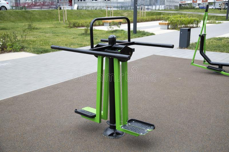 Power trainer for leg muscles made of metal on the Playground in the city outdoors. royalty free stock photos