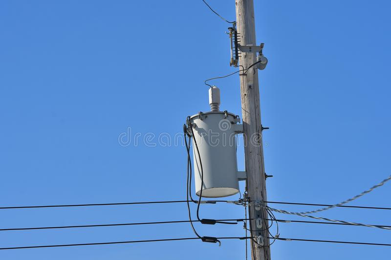 Power Tranformer. An image of a power transformer on a wooden power pole stock photography