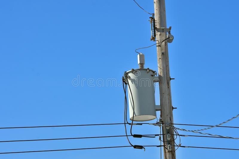 Power Tranformer. An image of a power transformer on a wooden power pole stock image