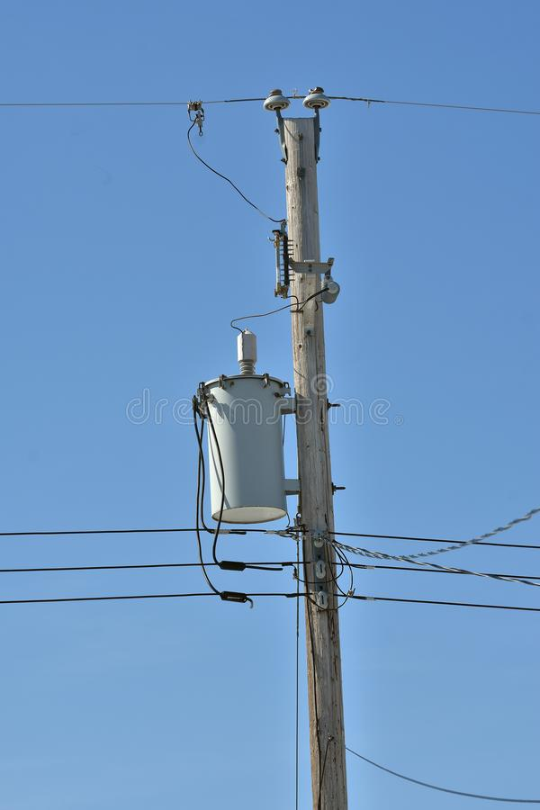 Power Tranformer. An image of a power transformer on a wooden power pole royalty free stock photos