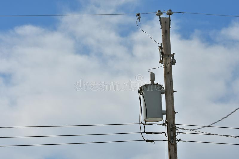 Power Tranformer. An image of a power transformer on a wooden power pole royalty free stock image
