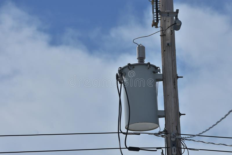 Power Tranformer. An image of a power transformer on a wooden power pole stock images