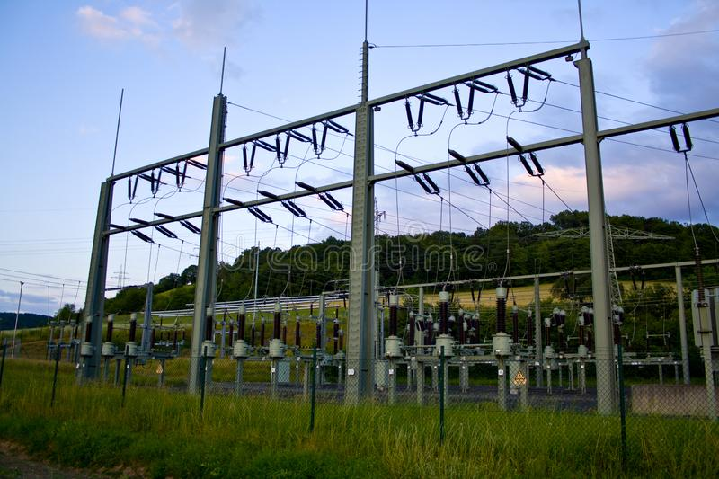 Power transformer in high voltage switchyard in modern electrical substation in Hesse, Germany stock photography