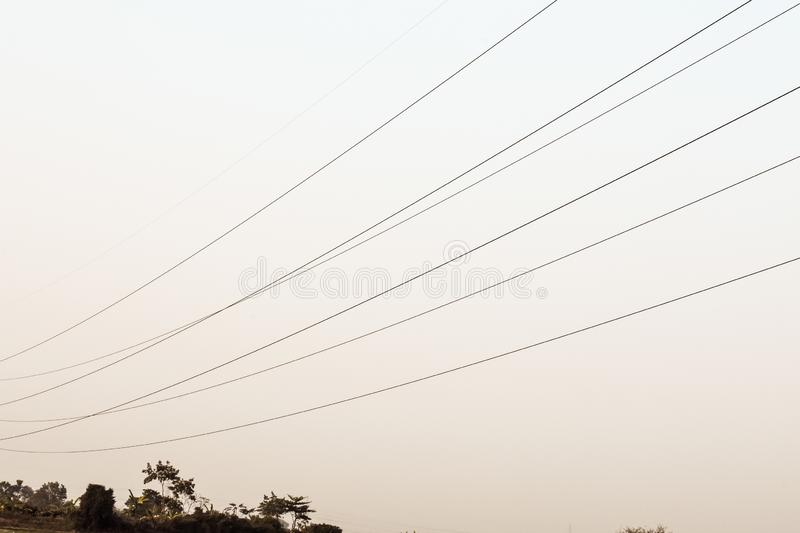 Power transmission line, electricity pylon, steel lattice tower high voltage overhead power line. Industrial background royalty free stock images