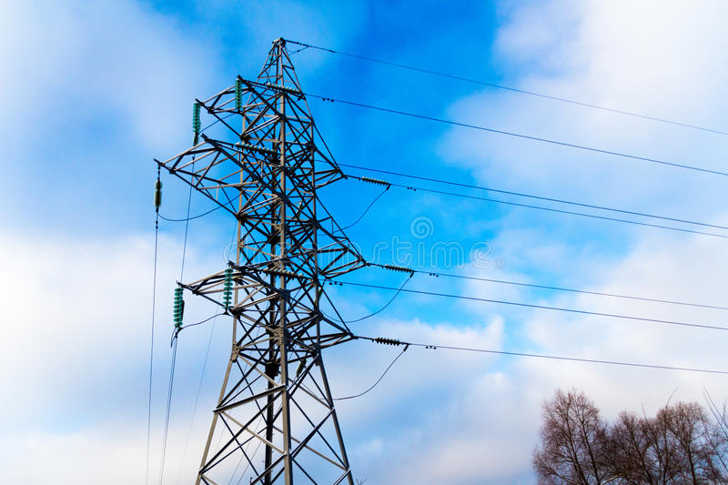 Power transmission line tower against blue sky and clowd with sn royalty free stock photo