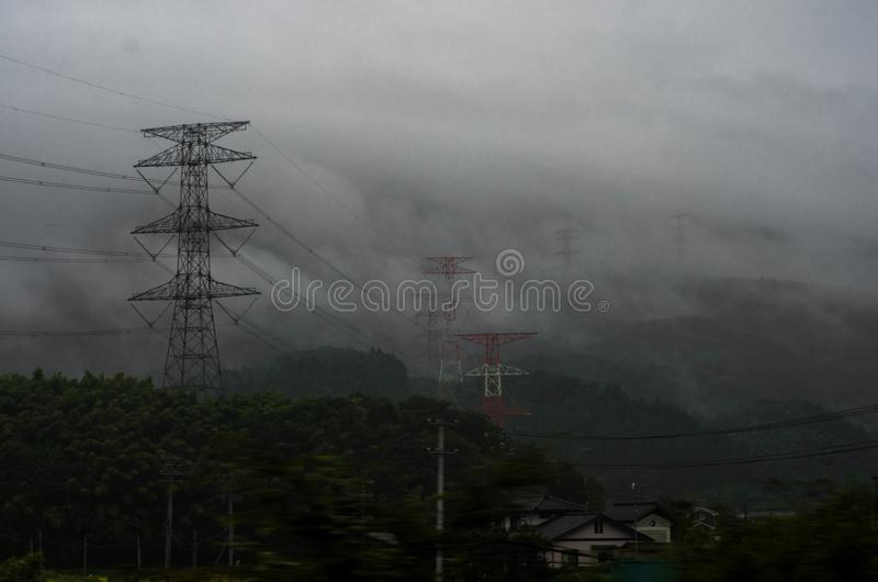 Power transmission tower in the fog, Japan. Honshu, japanese autunm royalty free stock photos