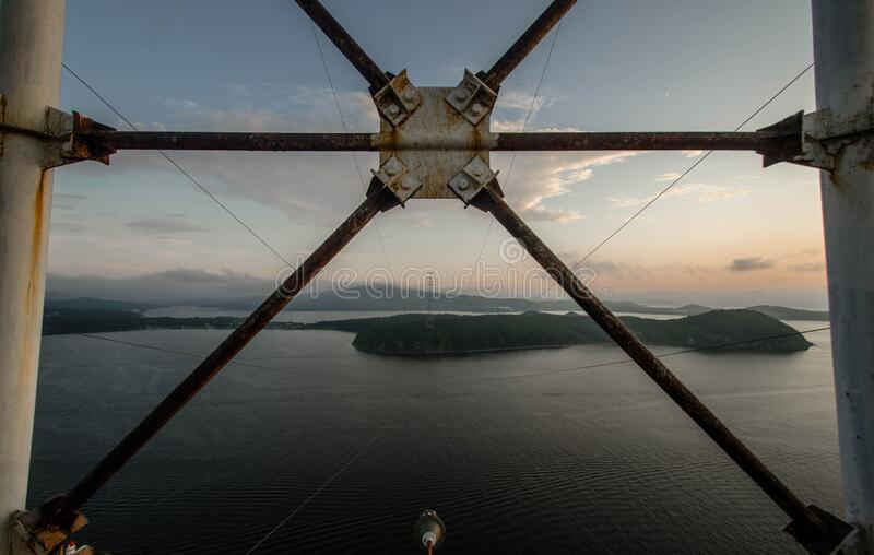 Power transmission tower 150m, Vladivostok. High power transmission tower 150m, Vladivostok, Russia, Eastern Bosphorus Strait royalty free stock photos