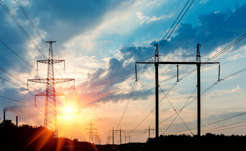 Download Power Transmission Tower Silhouetted Against The Sunset Glow. Stock Image - Image of industrial, tower: 98869605