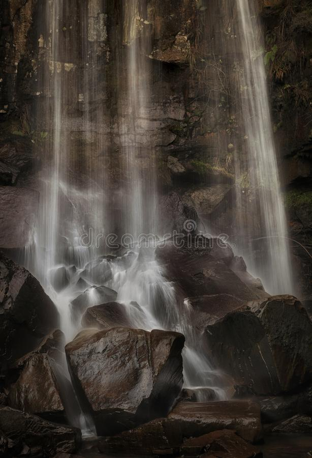 Water and wet rocks at Melincourt. The power of the waterfall at Melincourt Brook in Resolven, South Wales, UK stock photos