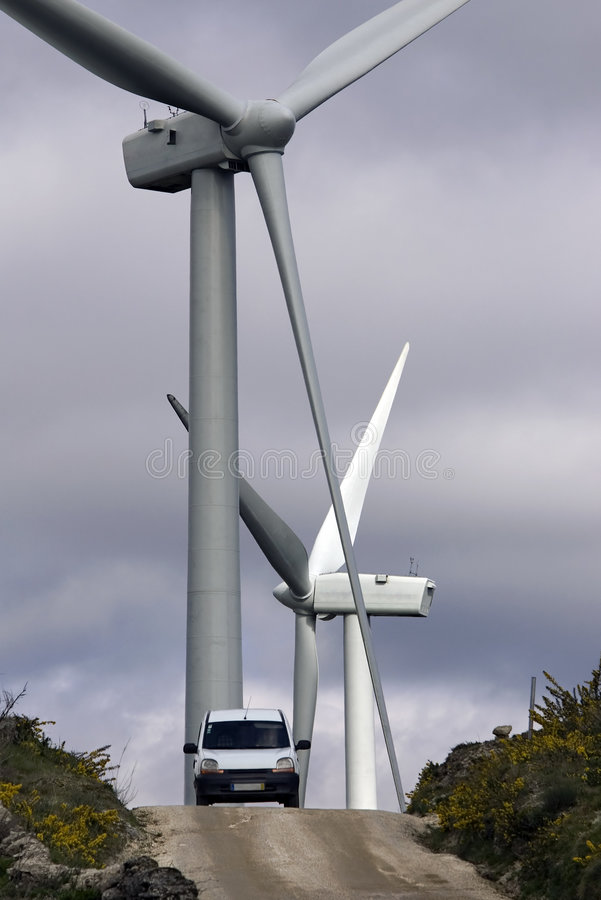 Power Windmills. Scale comparison between a car and power windmills royalty free stock image
