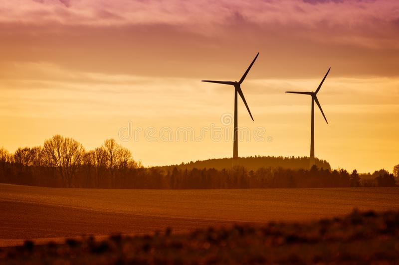 Power Windmills with fields and trees. In Bavaria, Germany royalty free stock photos