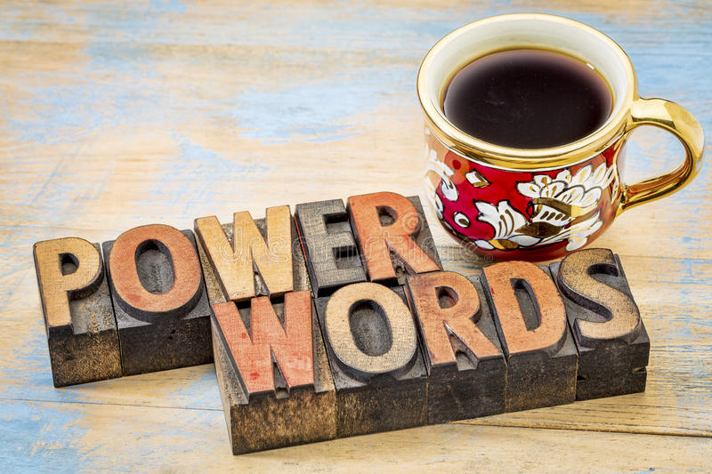 Power words in vintage letterpress wood type. Power words - word abstract in vintage letterpress wood type printing blocks against painted wood with a cup of royalty free stock image