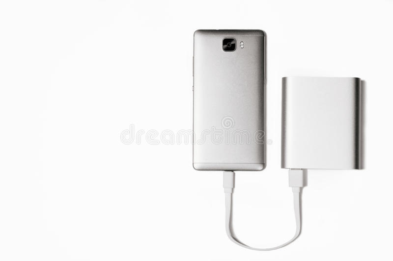 Powerbank charge smartphone isolated white royalty free stock images