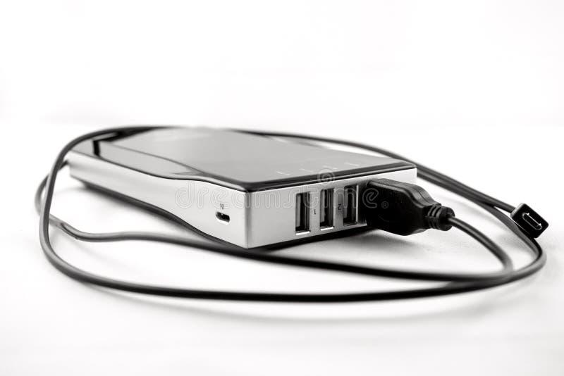 Powerbank negro aislado con el cable tapado fotos de archivo