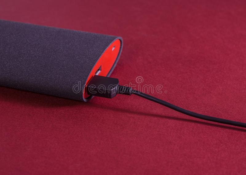 Powerbank on red background royalty free stock image