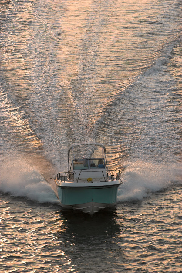 Download Powerboat at sunset stock image. Image of sunset, wake - 1295445