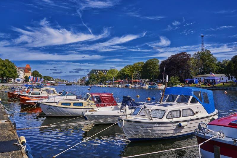 Powerboats moored in the harbor in Mecklenburg-Vorpommern on the Baltic Sea. Warnemünde, Germany. Ostsee, warnemünde, water, retro, cruise, city, europe royalty free stock image