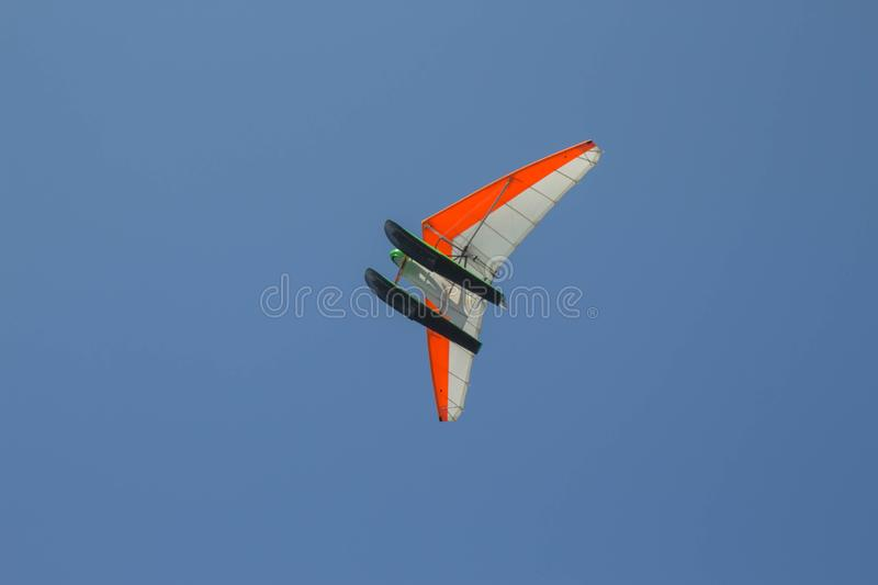 Powered hang glider, para glider. sail flying object on beautiful blue sky royalty free stock photography