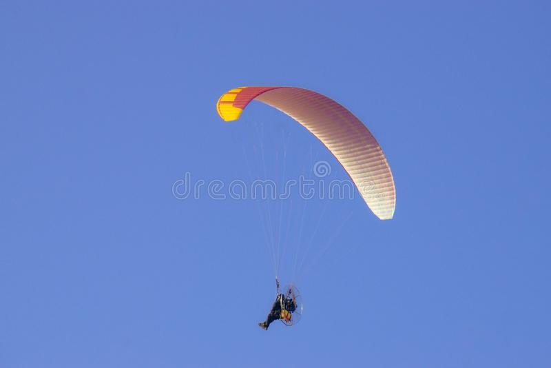 Powered Paraglider in blue sky. royalty free stock images