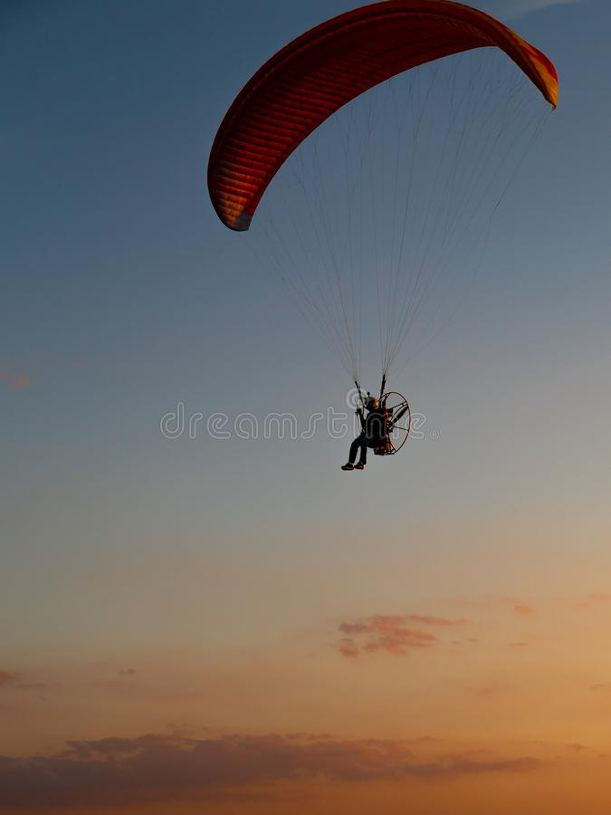 Powered paragliders performing night airshow stock photos