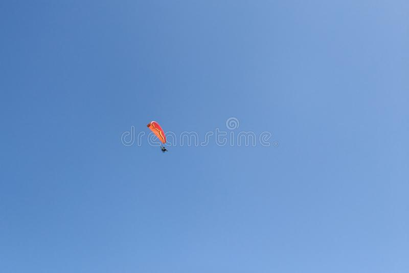 Powered paragliding - paraglider with red parachute royalty free stock photography