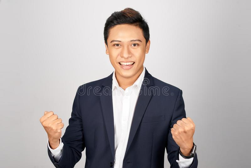 Powerful Asian business man on white background.  stock photography