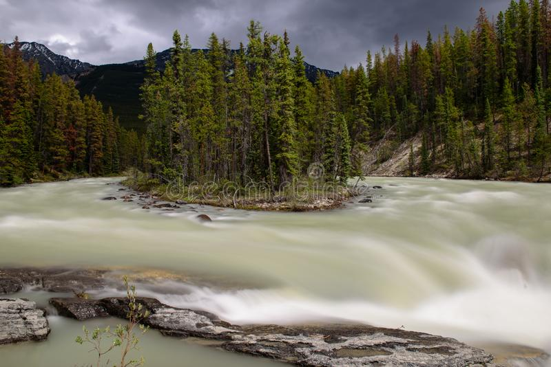 Sunwapta falls by a cloudy day royalty free stock image