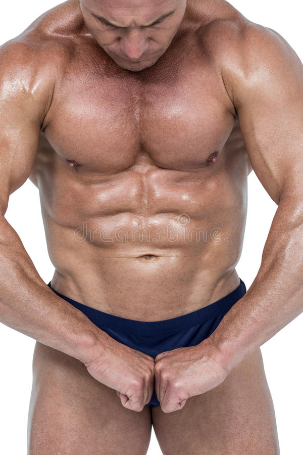 Powerful athlete flexing muscles. Against white background stock image