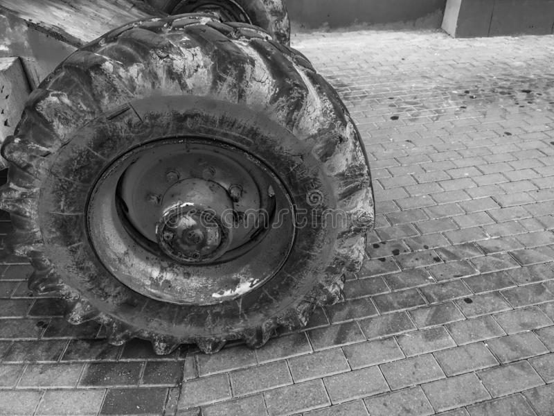 Powerful big wheels with tread and tires of off-road construction equipment, tractors, cars stock image