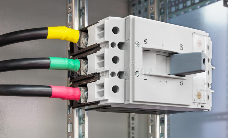 Powerful block electrical circuit breaker. Mounted in the electrical cabinet royalty free stock photo