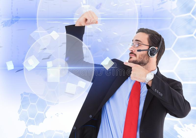 Powerful business man with a digital interface as background. Composite images of powerful business man with a digital interface as background stock photo