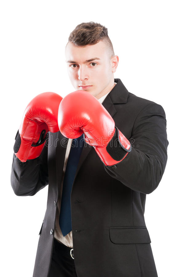 Powerful business man. Wearing red boxing gloves and black elegant suit and tie stock image