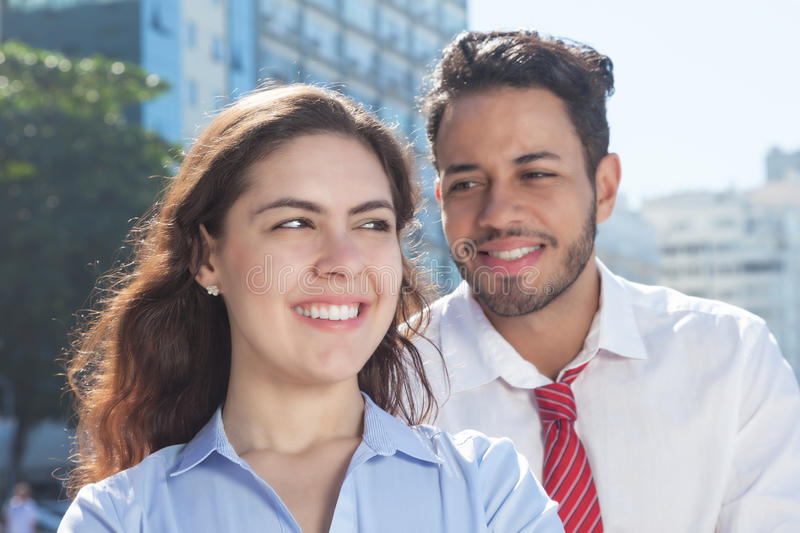 Powerful business team in the city. With modern office buildings and blue sky in the background royalty free stock photos