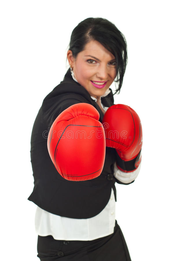 Powerful business woman in attack. Isolated on white background,selective focus on boxing glove stock image